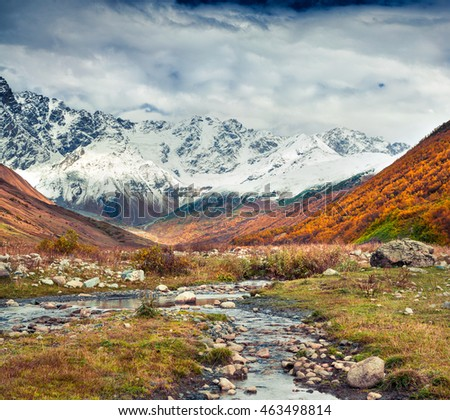Southern foothills of mountain Shkhara. View from Ushguli village. Colorful autumn morning in Caucasus mountains, Upper Svaneti, Georgia, Europe. Artistic style post processed photo.
