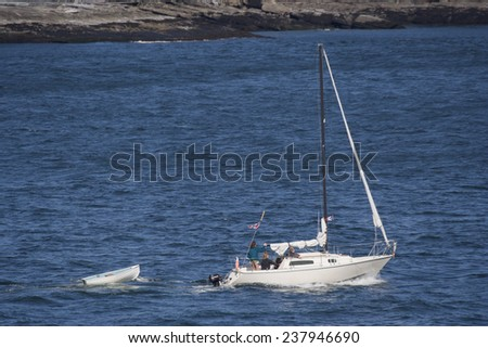 SOUTHERN GULF ISLANDS - AUGUST 4, 2005: Sailboat between the Southern Gulf Islands on the Pacific Ocean in Canada. Mother and two daughters are enjoying this touristic highlight in British Columbia. - stock photo