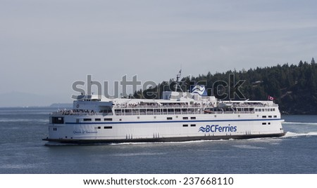 "SOUTHERN GULF ISLANDS, CANADA - AUGUST 4, 2005: Ferry ""Queen of Vancouver"" of BC Ferries is passing the Southern Gulf Islands. The ferry ride from Swartz Bay to Tsawassen is a touristic highlight. - stock photo"
