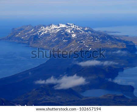 Southern part of  Jan Mayen island from slope of volcano Beerenberg - stock photo