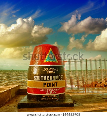 Southernmost Point sign in Key West, Florida. Beautiful seascape with sunset sky. - stock photo