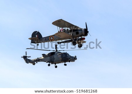 SOUTHPORT, ENGLAND, SEPTEMBER 19, 2015, Royal Navy Fairey Swordfish biplane and AgustaWestland AW159 Wildcat ( black cats ) helicopter airshow flypast