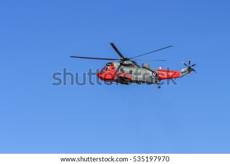 SOUTHPORT, ENGLAND, SEPTEMBER 19, 2015, Royal Navy Seaking Search and Rescue helicopter hovering ready to perform a mock rescue at the Southport airshow