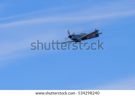 SOUTHPORT, ENGLAND, SEPTEMBER 19, 2015. Vintage Supermarine Spitfire aircraft displaying against a blue sky with light clouds  at the Southport airshow