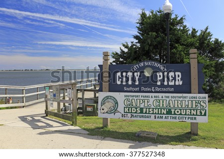 Southport, NC, USA - September 30, 2015: Southport City Pier and signs entrance to the wooden pier outside on a sunny day. City Pier of Southport signs on an autumn day.