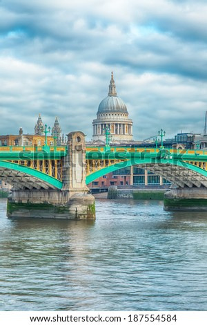 Southwark Bridge and st. Paul's Cathedral on the background on a cloudy morning