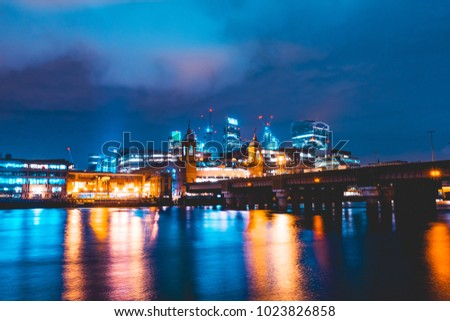 Southwark Bridge at night with london cityscape in the background