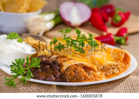 Southwest beef enchilada with sourcream and black beans.