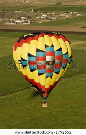 Southwest Hot Air Balloon above Town - stock photo
