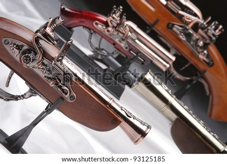 Souvenir antique pistols in an interesting photocomposition