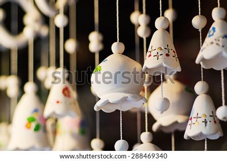 Souvenir ceramic bells at the market, local national craft of Ukraine - stock photo