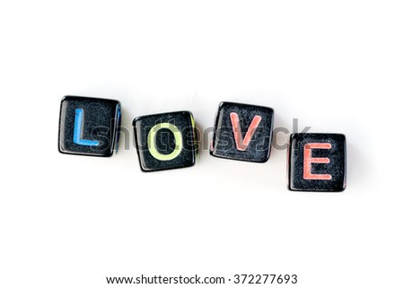 Souvenir cubes with letters crossed in the word love. Isolated