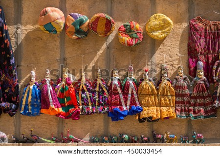 Souvenir Rajasthan puppets hanging in the street shop of Jodhpur, India - stock photo