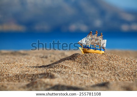Souvenir sailing vessel on a beach - stock photo