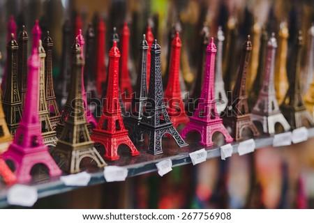 souvenir shop in Paris, small Eiffel towers for sale - stock photo