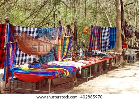 Souvenir stand selling tapestries and hammocks in Chichen Itza, near Cancun, Mexico - stock photo