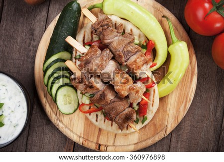 Souvlaki or kebab, grilled meat skewer with pita bread - stock photo