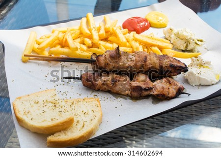 Souvlaki portion on a table in a restaurant - stock photo