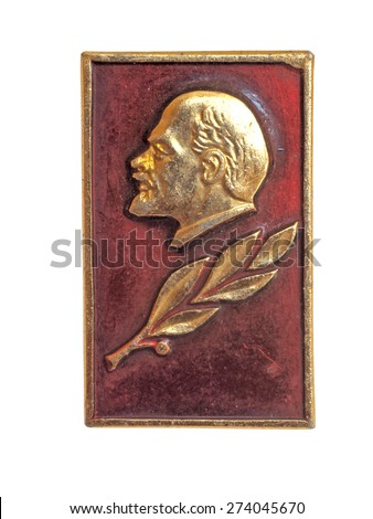 Soviet russian badge Lenin head profile relief on red flag background - stock photo