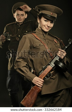 Soviet sentry on patrol with a girl - stock photo