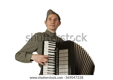 Soviet soldier dressed in uniform of World War II playing the accordion over white background