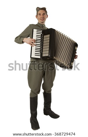 Soviet soldier in uniform of World War II playing the accordion isolated on white background