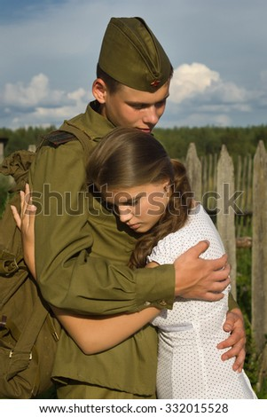 Soviet soldier in uniform of World War II saying goodbye to girl. No intellectual property  - stock photo