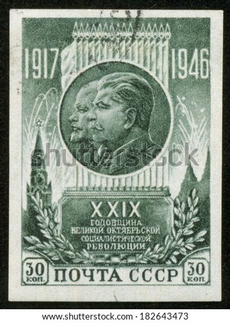 SOVIET UNION - CIRCA 1946: A stamp printed by the Soviet Union Post is a entitled 29 years to the Russian revolution. It shows portraits of Lenin and Stalin, circa 1946