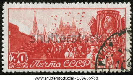 SOVIET UNION - CIRCA 1947: A stamp printed by the Soviet Union Post shows May Day demonstration at Red Square in Moscow, circa 1947. - stock photo