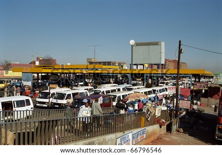 SOWETO, SOUTH AFRICA - JULY 18: Local bus station, July 18, 2005 at Soweto, South Africa. Transport in Africa is by local minibuses. You can get anywhere with these small vehicles.