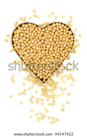 Soy bean in heart shape isolated on white background - stock photo