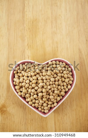 soy bean in the heart shape container - stock photo