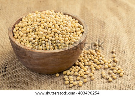 soy bean in wood bowl on table - stock photo