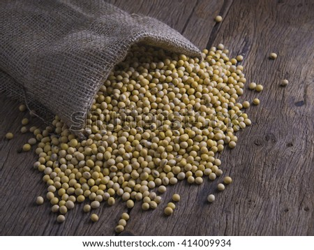 soy bean on wooden background - stock photo