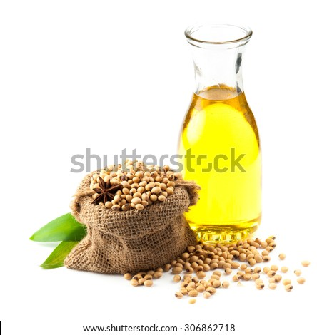 Soy beans and oil on white background - stock photo