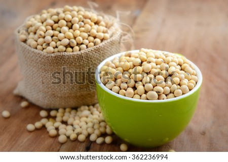 Soy beans in green bowl and sack - stock photo