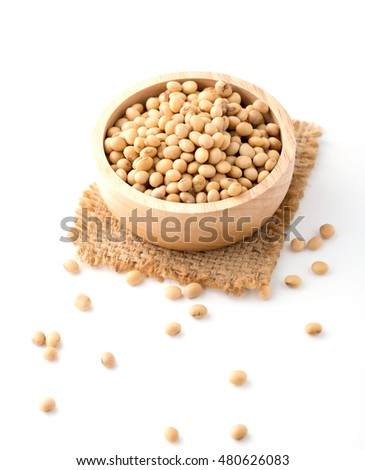 soy beans in wooden bowl on white background