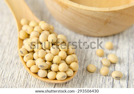 soy beans in wooden spoon - stock photo