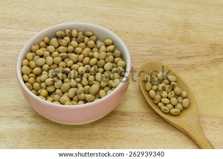 Soy beans on wood background - stock photo