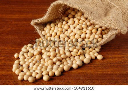 Soy beans on wood table - stock photo