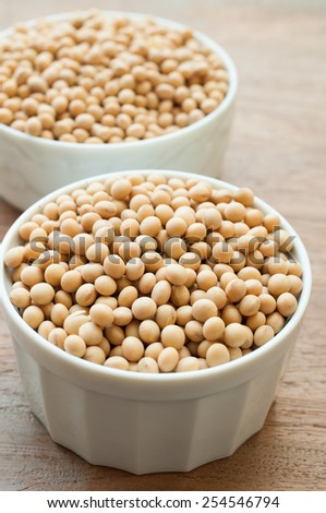 Soy beans on wooden board