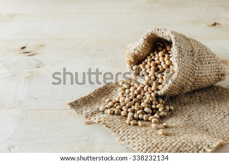 soy beans on wooden table - stock photo