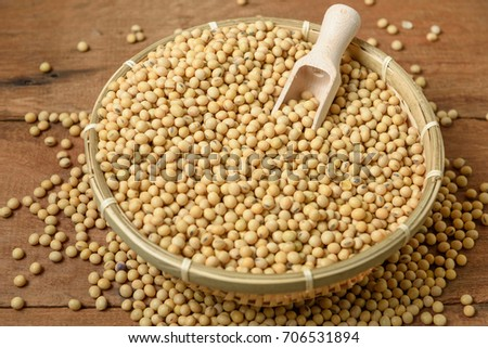 Soy beans with wooden spoon in bamboo basket