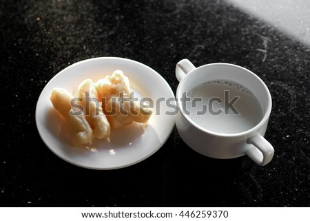 soy milk and deep fried doughstick with sweetened condensed milk on top