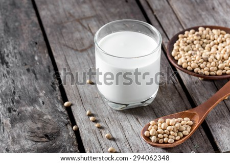 Soy milk and soy bean on wood background - stock photo