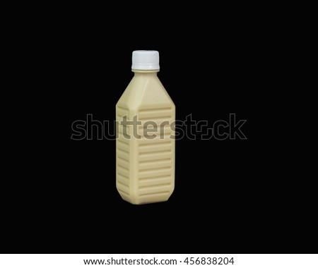 Soy milk bottle black isolated - stock photo