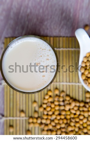 Soy milk glass and soy beans  - stock photo