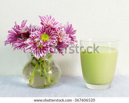 Soy milk with green tea - stock photo