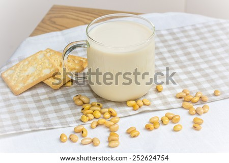Soy milk with soy bean and cracker - stock photo