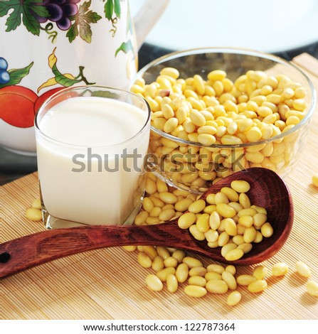 soy milk with soy beans background - stock photo